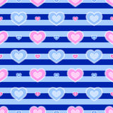 Stripped background. Background with seamless pattern made of hearts in blue and pink colour Royalty Free Stock Photo