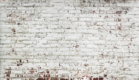 Stripped bricks red wall with paint in white Royalty Free Stock Photo