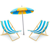 Stripped deck-chair with umbrella beach inventory Royalty Free Stock Photos
