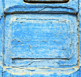 stripped paint in the blue wood door and rusty nail Stock Photos