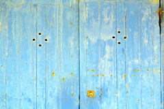 stripped paint in the blue wood door  rusty nail Stock Photos
