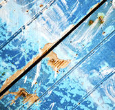 Stripped paint in the blue wood door and rusty nail Royalty Free Stock Image