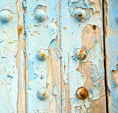 stripped paint in the  wood door and rusty nail Stock Photo