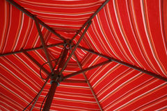Stripped Umbrella. A stripped umbrella used to provide shade on a patio or on a beach Royalty Free Stock Photo