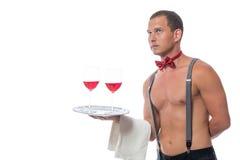 Stripper δίνει ένα κόκκινο κρασί σε έναν δίσκο Στοκ Εικόνα