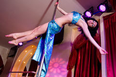 Stripper Girl Pole Dancing In Costume Stock Photography