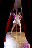 Stripper girl pole dancing in nurse costume Royalty Free Stock Photo
