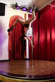 Stripper hanging on pole Royalty Free Stock Photos
