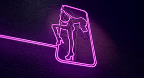 Stripper Sign. An illuminated neon pink sign for a strip club mounted on a wall incorporating a dancing girl royalty free stock images