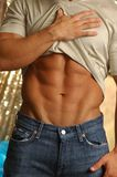 Stripping male abdomen muscle Stock Photo