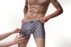 Stripping male boxers for a woman Stock Photo