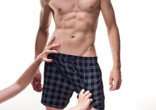 Stripping male boxers for a woman Royalty Free Stock Photo