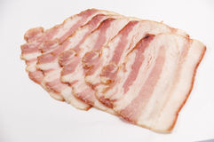 Strips of bacon on a white background Royalty Free Stock Photos