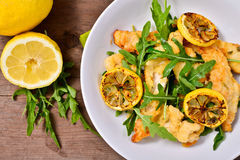 Strips of chicken with rocket and lemon Stock Images