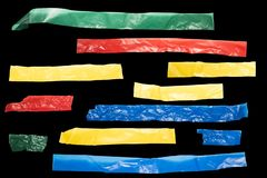 Strips of colored tape on a black background for lower third royalty free stock images
