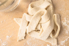Strips of dough cooked pasta Stock Images