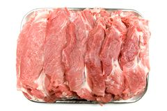 Strips of Fresh, Raw Meat. Strips of fresh raw meat in a pan, ready to be taken to the grill for cooking.  Isolated on a white background Stock Photos