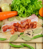 Strips of fried bacon on wooden Royalty Free Stock Photos