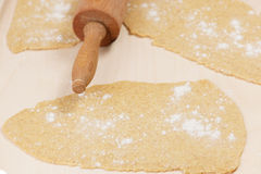 Strips from homemade spelt dough for noodles on wooden table. Royalty Free Stock Image