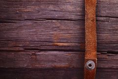 Strips of leather on a wooden plank. The distinctive cowboy deta Stock Photo
