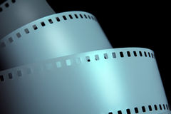 Strips of negative film strip on a dark background. Stock Image