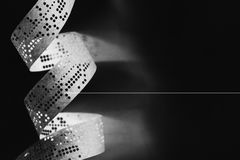 Strips of old punched tape on a white surface Royalty Free Stock Photography