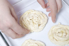 Strips of puff pastry, woven into a pigtail. Preparation of baking Stock Images