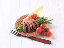 Strips of roast beef  and vegetables Stock Photo
