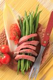 Strips of roast beef  and vegetables Royalty Free Stock Images
