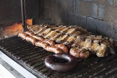 Strips of veal rib, chorizo ​​and blood sausage, Argentina barbecue.  stock image
