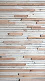 The strips of wood in two colors glued to the wall. Stock Image