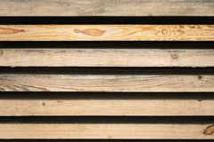 Strips of wooden boards on a black background. Wood lumber. Stock of timber wood construction in warehouse. Strips of wooden boards on a black background. Wood royalty free stock photos