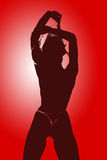 Striptease. Soilhouette of young adult girl doing striptease Royalty Free Stock Image