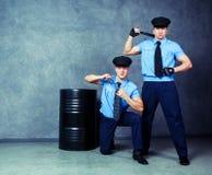 Striptease dancers policemen. Striptease dancers wearing costumes of policemen in the studio Stock Photo