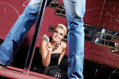 Striptease for girl. The man dances a striptease for the girl Royalty Free Stock Images