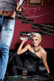 Striptease for money. The glamour girl observes of an undressing of the man in night club Royalty Free Stock Photo