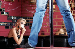 Striptease for the woman. The man dances a striptease in night club Royalty Free Stock Photography