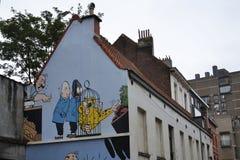 Stripverhaalmuurschildering het schilderen in Brussel, België Stock Foto's