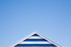 Stripy beach hut top. Abstract of summer sky and stripy beach hut top Stock Photography