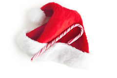 Stripy candy cane and xmas hat Stock Images