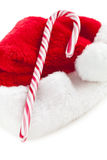 Stripy candy cane and xmas hat Royalty Free Stock Image
