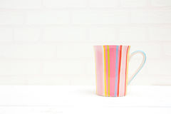 Stripy coffee cup. On a white background stock photos