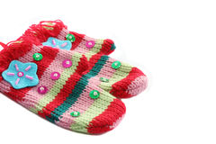 Stripy colorful decorated mittens. Christmas tree decoration Royalty Free Stock Images