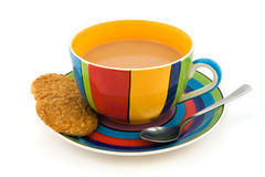Stripy cup and saucer & biscuits isolated on white Royalty Free Stock Photography