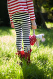 Stripy legs and teddy in meadow. Stock Photos
