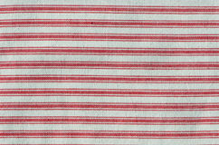 Stripy red fabric. Pattern of stripy red and white tea towel stock photo
