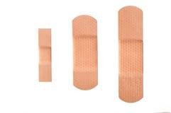 Strisce adesive della fasciatura isolate Immagini Stock Libere da Diritti