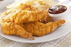 Strisce croccanti organiche del pollo Fotografia Stock