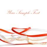 Strisce del nastro lucido rosso e bianco con stringa Fotografia Stock