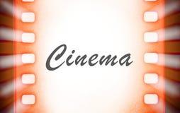 Strisce di pellicola del cinema con e raggi luminosi del proiettore fotografia stock